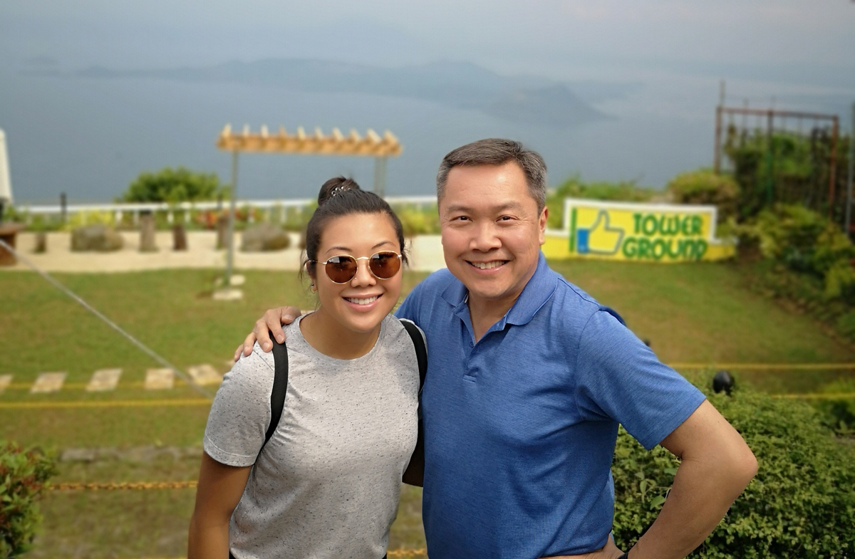 Ramon Jacinto poses with daughter Kim, by Taal Lake in Tagaytay, Philippines, home to one of the world's smallest volcanoes at only 311 meters (photo courtesy of Ramon Jacinto).
