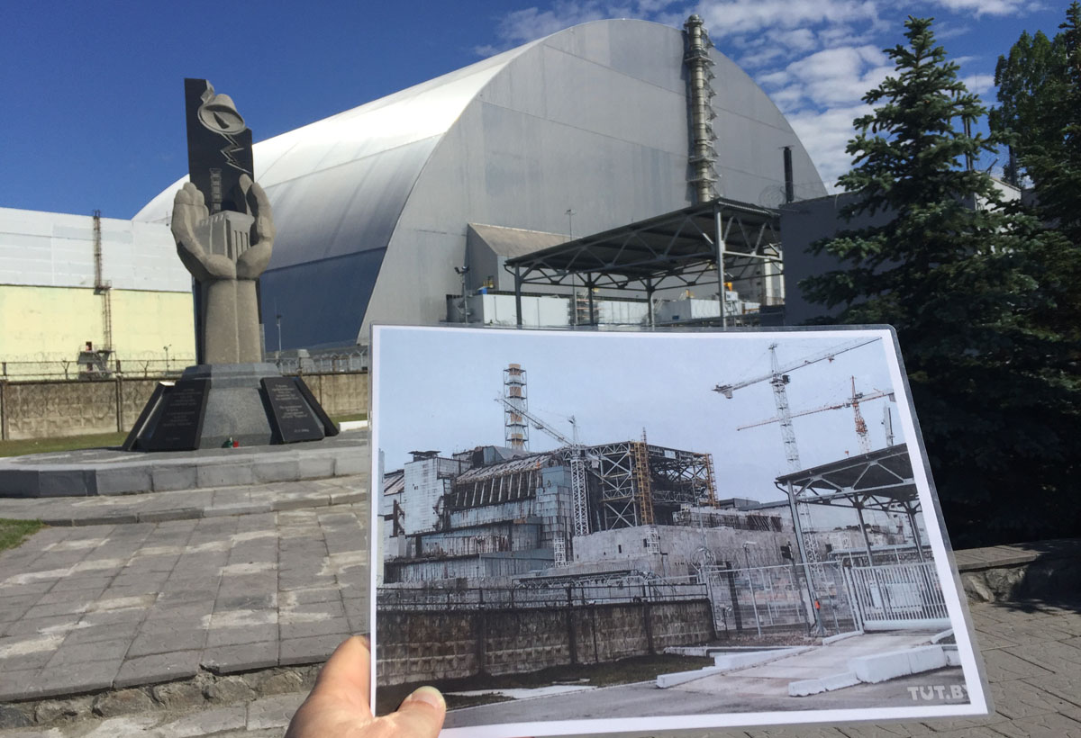BEFORE & AFTER: A photo of Chernobyl's No. 4 reactor following the 1986 explosion is held in the exact spot the image was captured, where a memorial to the disaster now stands (photo courtesy of Vincent Rees)