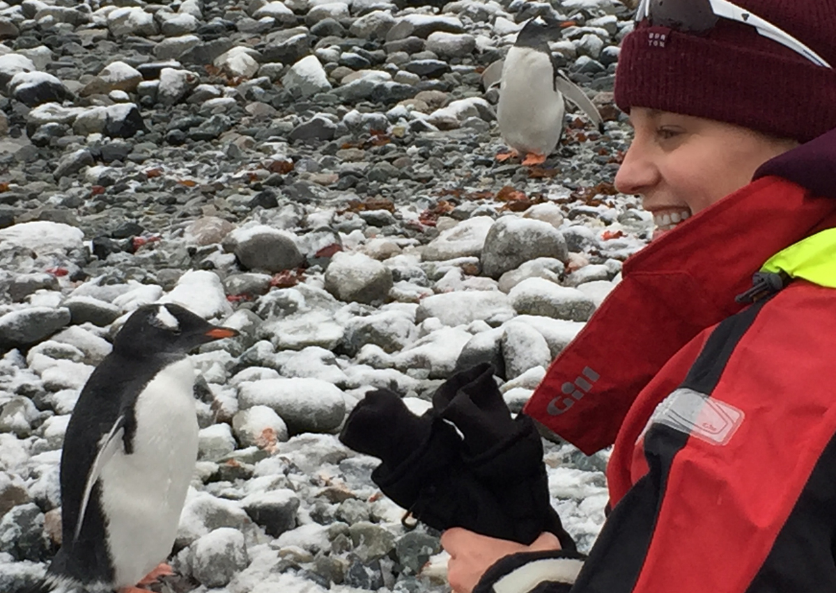 Making a new friend in Antarctica (photo courtesy of Eva Horne)