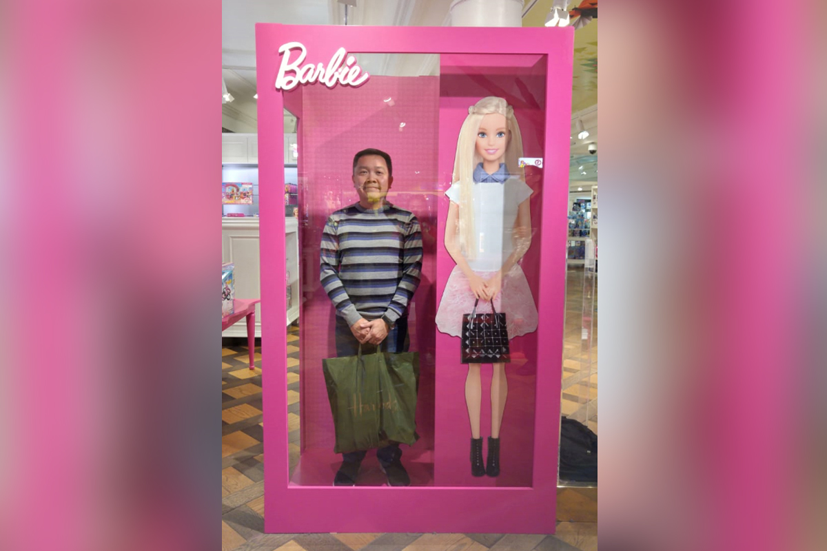 Posing with Barbie at the Barbie Museum in London, England (photo courtesy of Ramon Jacinto)