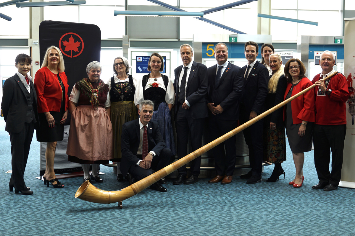 Travellers at YVR on Aug. 1 were wished a happy Swiss National Day by a Swiss alphorn and yodeling band, organized by the Consulate General of Switzerland in Vancouver. (From left) Lydia Stiglich, Lufthansa Group/SWISS, Pascal Bornoz, Consul General of Switzerland in Vancouver, Urs Eberhard, Deputy CEO, Switzerland Tourism, Steve Goodfellow, Director Sales - Eastern / Western Canada, Pascal Prinz, Director Canada, Switzerland Tourism, Nina Bader, Consulate General in Vancouver, Antje Fierro, Lufthansa Group/SWISS, Edna Ray, Senior Key Account Manager – Global Sales, Air Canada.