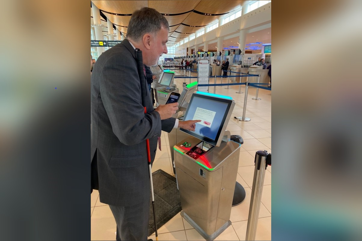 Paul Shroeder, vice-president, Public Policy and Strategic Initiatives, Aira, uses the app to navigate to a check-in kiosk.
