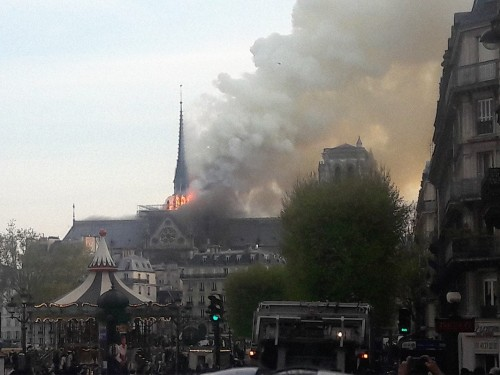 Millions pledged to rebuild torched Notre Dame